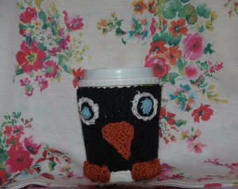 knitted penguin cup cosy