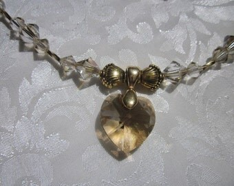 Swarovski Golden Shadow heart necklace crystal earrings sparkle with elegant radiance