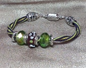 Lamp work Beaded Kumihimo braided 7 3/4 inch bracelet