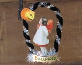 """Halloween Bottlecap Tree Ornament -  about 3.25"""" tall  and 2.5"""" wide - the images stand in a  bottlecap base       Ready to Ship"""