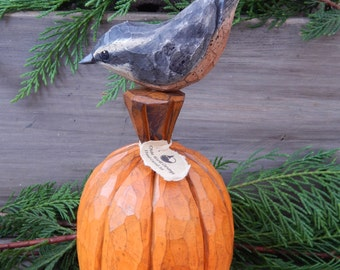 Hand Carved Nut Hatch on Carved Pumpkin.