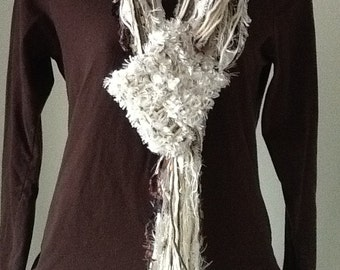 Beige, white, brown fringe scarf. Made from ultiple strands of various art yarns