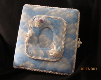 Baby Boy or children's album. blue background with clouds for dreaming. Available