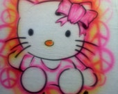 Airbrushed Hello Kitty t-shirt, any size (youth small to adult xl).  Includes name and background: peace signs, hearts, stars and glitter