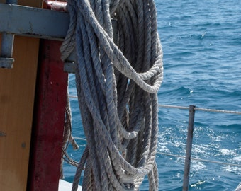 A sheet coiled on the mast of a sailboat photo