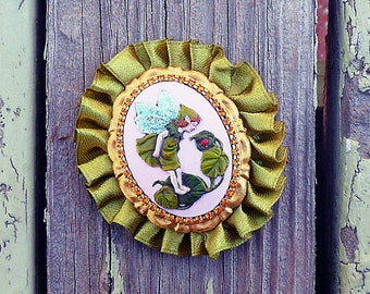 hand painted fairy cameo brooch with ribbon ruffle and glittery wings