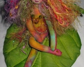 Enchanting fiber sculpted butterfly fairy on silk leaf