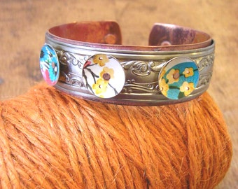 Vintage steel and reclaimed tins, patinaed copper cuff. Teal and yellow.