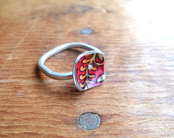 Silver ring featuring recycled tins. Crimson Fern.