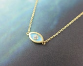 blue evil eye necklace in gold