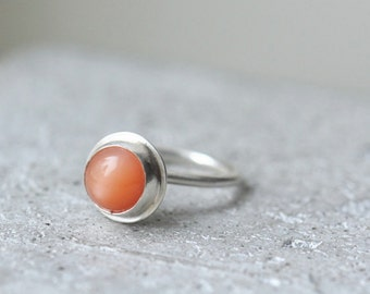 Moonstone cocktail ring sterling silver with brushed finish and peach moonstone. Drop shaped band size 5.25
