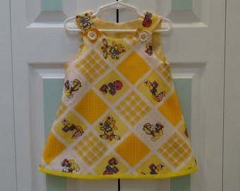 SLEEVELESS TODDLER'S DRESS -size 6 to 12 months, daisy buttons, yellow lining yellow bias tape