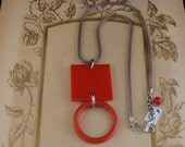 Retro necklace with repurposed red belt parts
