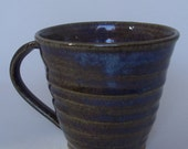 Stoneware coffee mug, tea cup. With blue beige glaze.