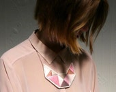 Bib necklace hand embroidered with light pink taupe and champagne colors geometric design