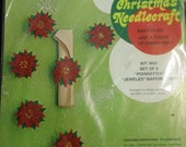 Bucilla Christmas Needlecraft Kit 1653 Set of Eight Poinsettia Jeweled Napkin Rings sealed holiday craft kit