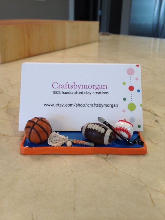 A Sports Fan Hockey and Baseball Football Polymer Clay Business Card Holder Stand