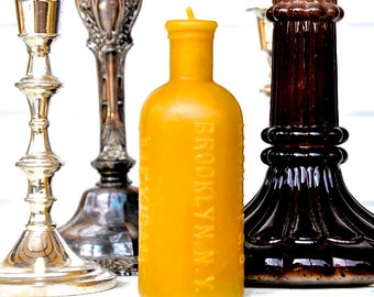 Brooklyn Candle: Beeswax Pillar, Mexican Mustang  Liniment, Beeswax Bottle Candle