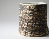 Hand built earthenware vessel with unique texture and aged look