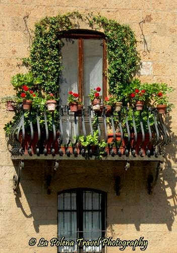 Italian balcony flowers yellow wall italy travel photo for Balcony wall decoration
