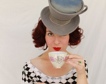 Custom Order: Mad Hatter Tea Cup Felt Tilt Hat with Iridescent Liquid Beverage and Curling Feathers for Steam