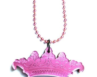 Pink Esoteric London crown logo charm necklace on pink chain