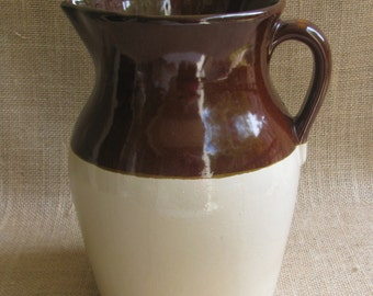Primitive Brownstone Pitcher  marked made in USA