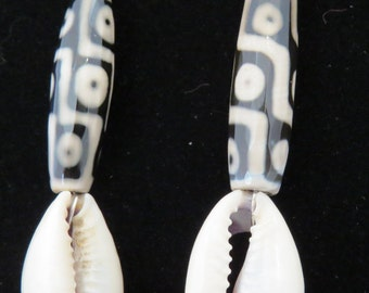 Earrings made of African Trade beads, cowry shells, sterling silver and agate.