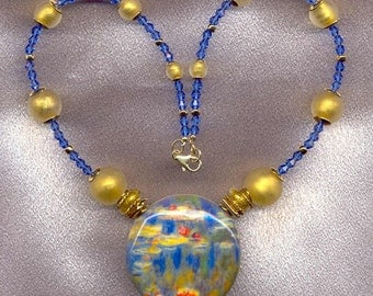 Alessandro's Design of Murano, Blown Glass, Disc shaped pendant, on a Venetian Glass Bead necklace of Gold Foil, Mat finished beads.