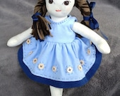 12 inch hand made doll. Brown haired, brown eyed doll made from upcycled cotton.  Blue, hand made cotton dress with wool felt shoes.