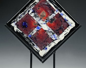 Black fused glass sculpture with reactive metal inclusions
