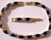 Blue Sapphire Crystal Bracelet Gold Tone Vintage Large Oval Faceted Clear Colored Stones Adjustable Length Double Foldover Clasp