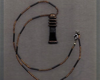 Egyptian black faience Djed pillar on glass beaded string - gold and black beads