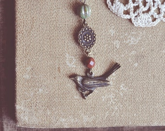 earthy beaded bird necklace.