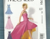 McCalls 6701 Fabulously Flirty & Flared  Evening Dress with High Low Hemline on a Fitted Drop Waist Bodice Sizes 14 to 22 UNCUT