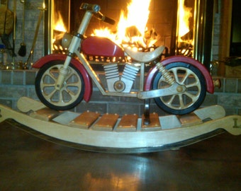 Beautiful rocking motorcycle made of oak with custom color stained tank and fenders. Wow your kids and your friends with this standout gift