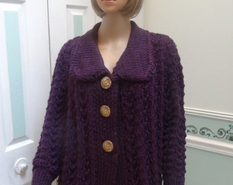 PURPLE SWEATER/COAT: Designer style, medium to large, hand knitted in an eco friendly, double yarn, with 3 gold buttons,acrylic yarn