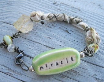 Miracle bracelet, mixed media