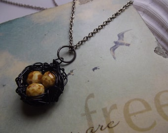Yellow Speckled Eggs Birds Nest Pendant Necklace To Benefit Heart Strings