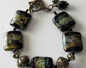 ON SALE Lampwork bracelet, black lampwork beads with swarovski crystals, antique brass, beaded jewelry