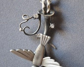 Falling Bird Necklace Made With Solid Cast Sterling Sivler Bird