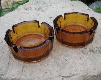 Heavy gold glass ashtrays - 2
