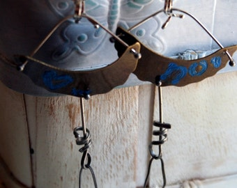 blue earrings. antiqued brass with silver ox and other accents