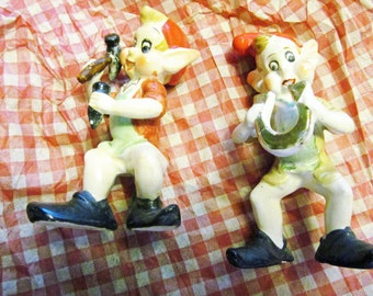 2 Vintage pixies, who look like the Rice Krispie Elves..probably from 50s or 60s