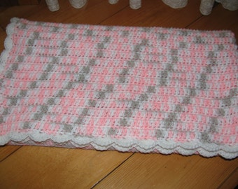 Warm crocheted baby girl pink and white blanket
