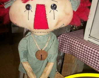 Primitive Christmas Annie doll with yarn hair and green check dress rusty jingle bell necklace