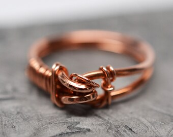 Woven buckle wirework ring in solid copper