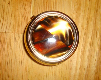 Beautiful gold plate pill box with hand turned cat's eye acrylic top/Coupon