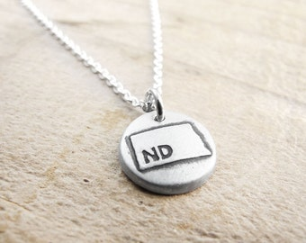 Tiny North Dakota necklace, silver state jewelry map pendant