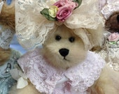 Small teddy bear and lacey bow